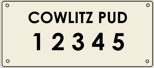 Pole identificatino plate reading 'Cowlitz PUD 1 2 3 4 5'